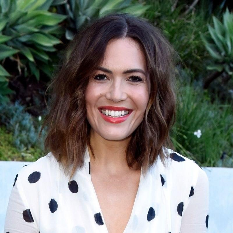 """Mandy Moore's medium shade is a bit warmer and richer — but still not overly red. Colorist <a href=""""https://www.instagram.com/nikkilee901/?hl=en"""">Nikki Lee</a>, cofounder of Nine Zero One Salon in Los Angeles, as well as <a href=""""https://www.allure.com/story/in-common-hair-care-nine-zero-one-founders?mbid=synd_yahoo_rss"""">In Common hair care</a>, is responsible for the shade she calls Autumn Glow. """"It feels like something you can wear on vacation and the end of summer, well into winter,"""" she says. """"If you have awarmer complexion, opt for a more golden look. If you have a cooler complexion, stick with ashier browns."""""""