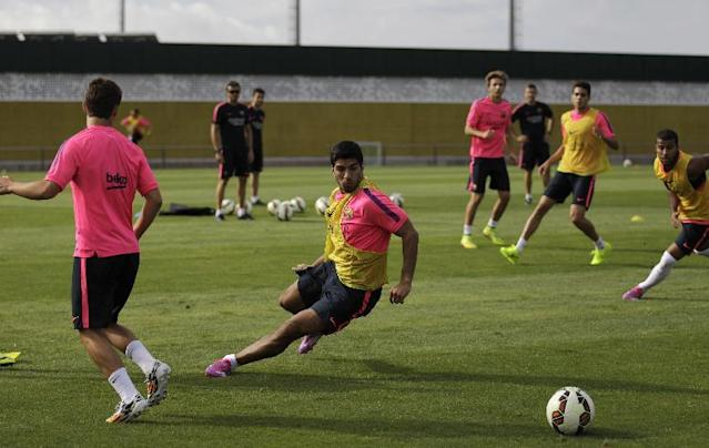 Luis Suarez, of Uruguay, runs during a training session at the Sports Center FC Barcelona Joan Gamper in San Joan Despi, in Barcelona, Spain, Friday, Aug. 15, 2014. Luis Suarez trained with his Barcelona teammates on Friday after his ban for biting an opponent at the World Cup was softened but not shortened. The Court of Arbitration for Sport ruled Thursday that the Uruguay forward, who recently left Liverpool for Barcelona, deserves his four-month ban from playing official matches for both his club and his country. (AP Photo/Emilio Morenatti )