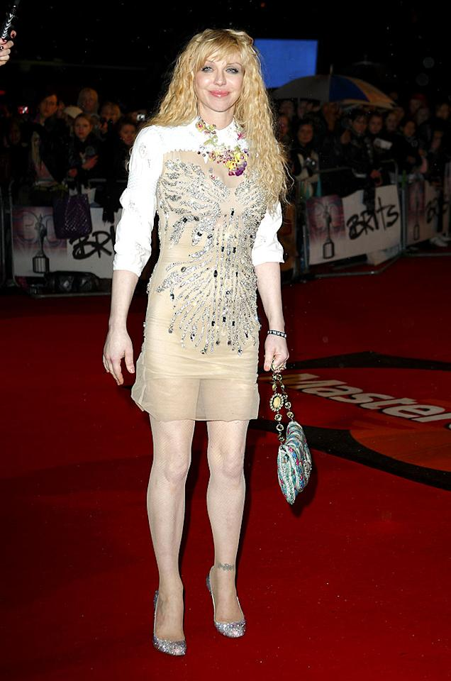 "Courtney Love was a rumpled mess in a nude embellished Miu Miu mini, which she unfortunately paired with a colorful necklace and bag that didn't match her look at all! Mike Marsland/<a href=""http://www.wireimage.com"" target=""new"">WireImage.com</a> - February 16, 2010"