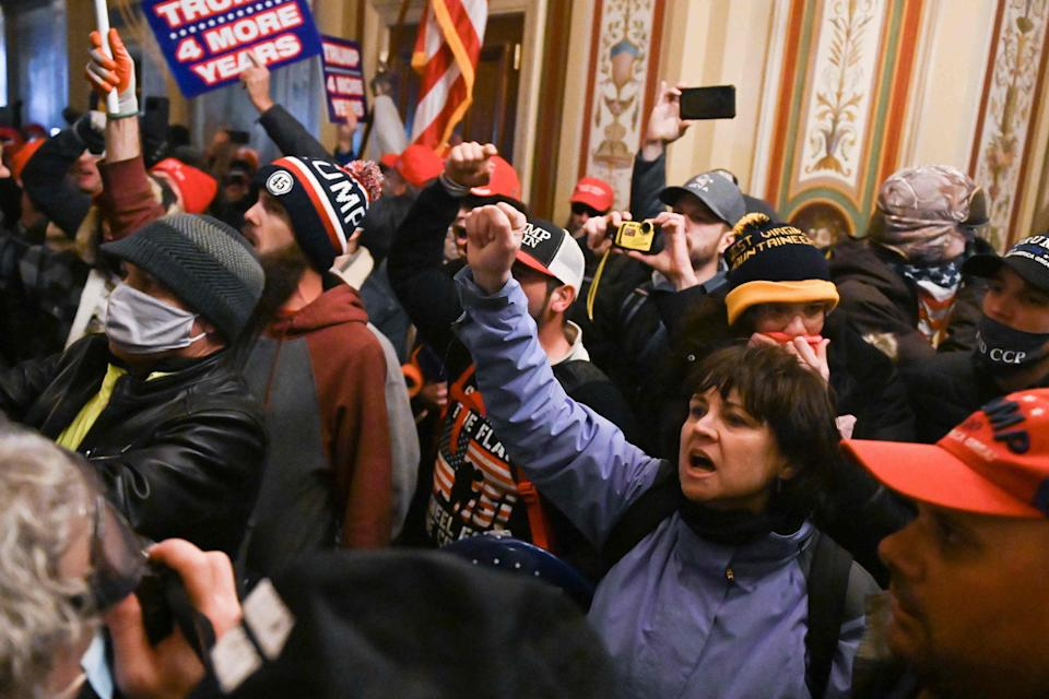 Supporters of US President Donald Trump protest inside the US CapitolAFP via Getty Images