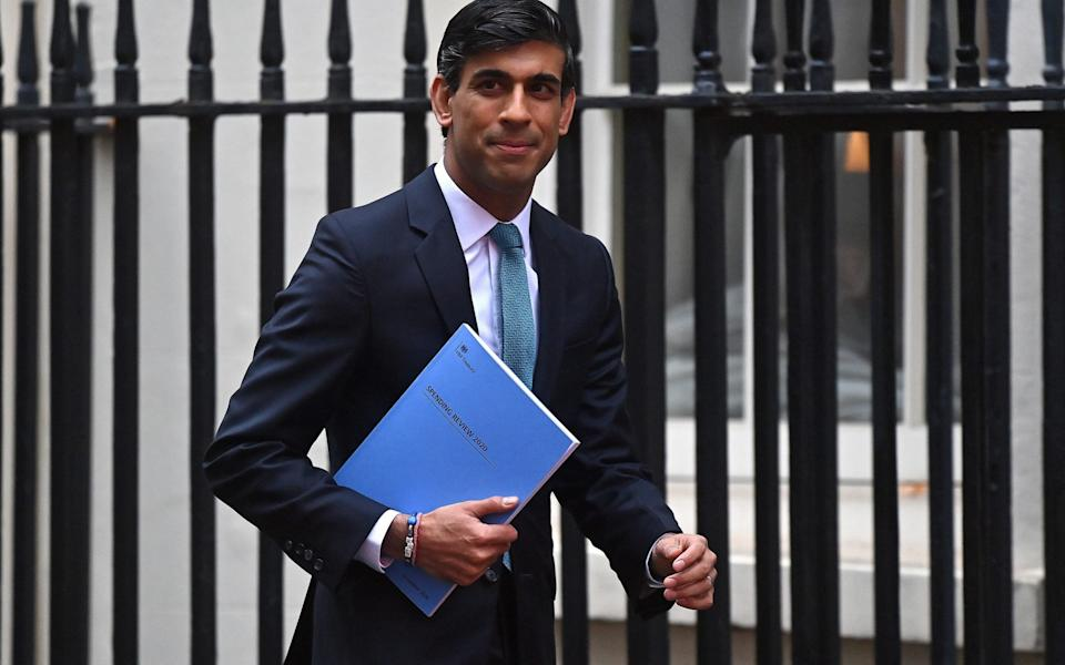 Britain's Chancellor of the Exchequer Rishi Sunak leaves 11 Downing Street in central London -  BEN STANSALL / AFP