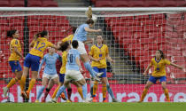 Manchester City's Sam Mewis, top, scores with a header her sides first goal during the Women's FA Cup final soccer match between Everton and Manchester City at Wembley stadium in London, Sunday, Nov. 1, 2020. (AP Photo/Kirsty Wigglesworth, Pool)