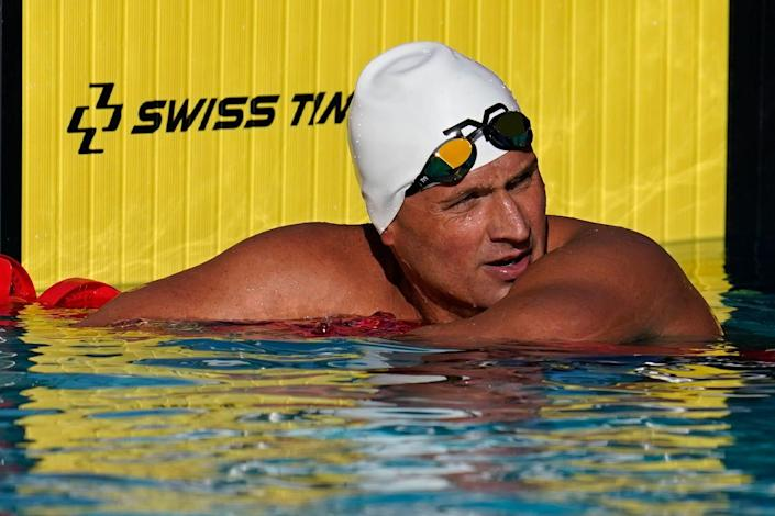 In this April 8, 2021, file photo, Ryan Lochte pauses after competing in the men's 200-meter freestyle preliminary race at the TYR Pro Swim Series swim meet in Mission Viejo, Calif.