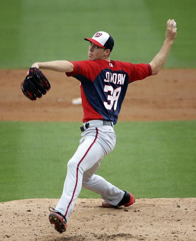 Washington Nationals starting pitcher Taylor Jordan throws in the second inning of an exhibition spring training baseball game against the Miami Marlins, Monday, March 24, 2014, in Jupiter, Fla. (AP Photo/David Goldman)