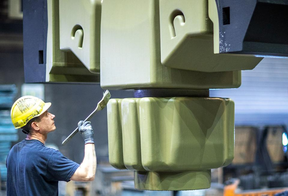 07 August 2020, Mecklenburg-Western Pomerania, Torgelow: An employee cleans a core pressed from sand in the mould construction area of the Torgelow iron foundry. The company, which with 320 employees is one of the most important employers in Western Pomerania, had filed for insolvency in mid-July. Photo: Jens Büttner/dpa-Zentralbild/ZB (Photo by Jens Büttner/picture alliance via Getty Images)