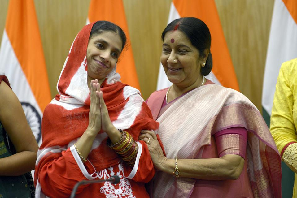 Deaf-mute Indian woman 'Geeta' is embraced by Sushma Swaraj after a press conference in New Delhi on October 26, 2015. (Photo by Yasbant Negi/The India Today Group via Getty Images)
