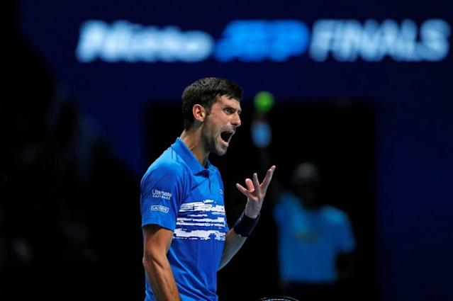 Novak Djokovic won his opening match at the ATP Finals (AFP Photo/Adrian DENNIS)