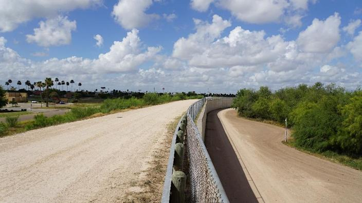 The border divide: a wall along one of the several layers of the US-Mexico border fencing in the border town of McAllen, Texas (AFP Photo/Gianrigo MARLETTA)