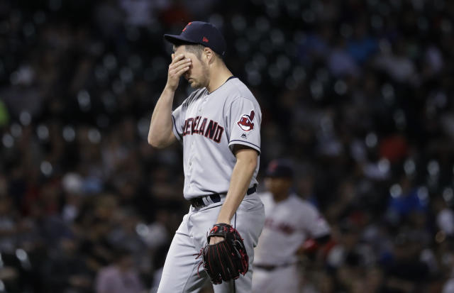 "<a class=""link rapid-noclick-resp"" href=""/mlb/teams/cle"" data-ylk=""slk:Cleveland Indians"">Cleveland Indians</a> starting pitcher <a class=""link rapid-noclick-resp"" href=""/mlb/players/9122/"" data-ylk=""slk:Trevor Bauer"">Trevor Bauer</a> wipes his face during the sixth inning of the team's baseball game against the Chicago White Sox on Wednesday, June 13, 2018, in Chicago. (AP Photo/Charles Rex Arbogast)"