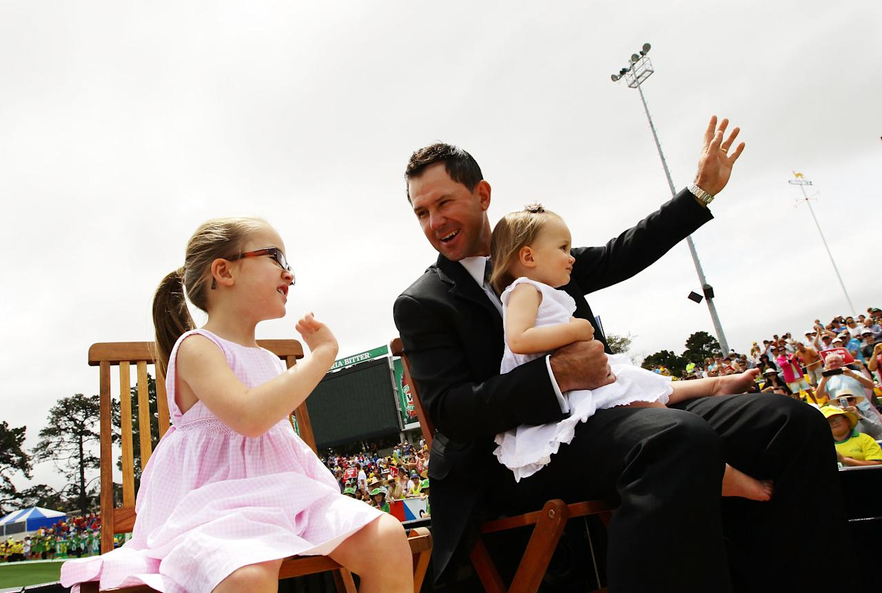 HOBART, AUSTRALIA - DECEMBER 14:  Ricky Ponting does a lap of honour with his daughters Emmy Ponting (L) and Matisse Ponting (R) during day one of the First Test match between Australia and Sri Lanka at Blundstone Arena on December 14, 2012 in Hobart, Australia.  (Photo by Matt King/Getty Images)