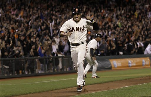 San Francisco Giants' Gregor Blanco celebrates as he scores on Buster Posey's base hit off of Colorado Rockies pitcher Matt Belisle during the eighth inning of a baseball game in San Francisco, Monday, May 14, 2012. (AP Photo/Jeff Chiu)