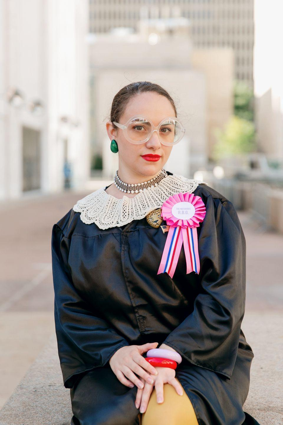 """<p>Pay homage to the second female justice of four to be confirmed to the highest court in our nation. Oversize spectacles and fun earrings make this one instantly recognizable. Pro tip: If you're really short on time, a black bathrobe works just as well as a real black robe.<br></p><p><a class=""""link rapid-noclick-resp"""" href=""""https://www.amazon.com/GradPlaza-Economic-Finish-inches-59-511/dp/B01GJIV82K?tag=syn-yahoo-20&ascsubtag=%5Bartid%7C10050.g.4571%5Bsrc%7Cyahoo-us"""" rel=""""nofollow noopener"""" target=""""_blank"""" data-ylk=""""slk:SHOP ROBES"""">SHOP ROBES</a> </p>"""