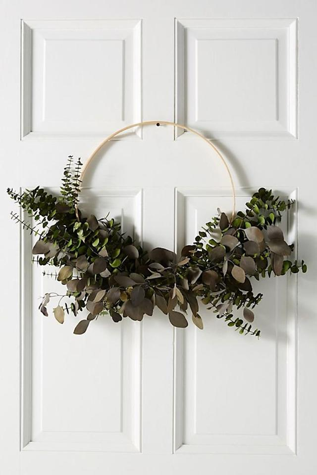 """<p>The real beauty of this wreath? You can keep it up year-round! Use the dried eucalyptus leaves as a base, then add a festive velvet ribbon or a few understated baubles to make it feel a bit more merry. Its wood hoop feels delightfully simple and Scandinavian, while the dried eucalyptus imparts a soft, beautiful scent.</p> <p><strong>To buy: </strong>$78, <a href=""""https://click.linksynergy.com/deeplink?id=93xLBvPhAeE&mid=39789&murl=https%3A%2F%2Fwww.anthropologie.com%2Fshop%2Fdried-silver-dollar-eucalyptus-wreath&u1=RS%2CTheBestSimpleYetSophisticatedHolidayDecorations%252CAllUnder%252480%2Ckholdefehr1271%2CDEC%2CIMA%2C680381%2C201910%2CI"""" target=""""_blank"""">anthropologie.com</a>. </p>"""