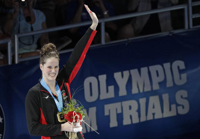 Missy Franklin waves during the medal ceremony for the women's 200-meter backstroke at the U.S. Olympic swimming trials, Sunday, July 1, 2012, in Omaha, Neb.(AP Photo/Nati Harnik)