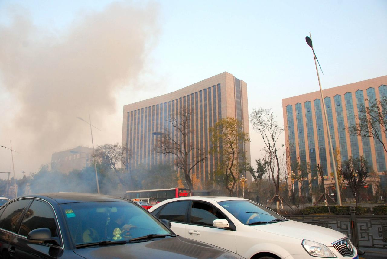A view of the site following explosions on Yingze Street in Taiyuan, the capital of north China's Shanxi Province, is seen in this picture taken and provided to Reuters by Xinhua News Agency November 6, 2013. According to Xinhua News Agency, one person was killed and eight others were injured after explosions on Wednesday morning in front of the office building of the Shanxi Provincial Committee of the Communist Party of China. REUTERS/Xinhua/Liu Guoliang (CHINA - Tags: CRIME LAW POLITICS TPX IMAGES OF THE DAY) NO SALES. NO ARCHIVES. FOR EDITORIAL USE ONLY. NOT FOR SALE FOR MARKETING OR ADVERTISING CAMPAIGNS. THIS IMAGE HAS BEEN SUPPLIED BY A THIRD PARTY. IT IS DISTRIBUTED, EXACTLY AS RECEIVED BY REUTERS, AS A SERVICE TO CLIENTS. CHINA OUT. NO COMMERCIAL OR EDITORIAL SALES IN CHINA. YES