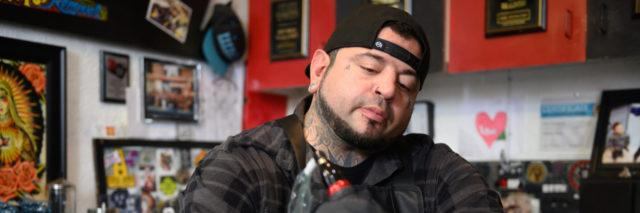 Tattoo artist Eric Catalano performs an areola tattoo procedure on Terri Battista's breasts at Eternal Ink Tattoo Studio on Nov. 20, 2019, in Hecker, Ill. After a double mastectomy following cancer in 2013, Battista had reconstructive surgery ― but held off on areola tattoos because of the cost. Then she heard about Catalano's shop, where breast cancer survivors could get the procedure done for free. (Michael B. Thomas for KHN)