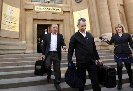 State prosecutor Gerrie Nel (L) leaves court after an appeal hearing brought by prosecutors against the six-year jail term handed to Oscar Pistorius for the murder of his girlfriend Reeva Steenkamp in Johannesburg, South Africa August 26, 2016. REUTERS/Siphiwe Sibeko