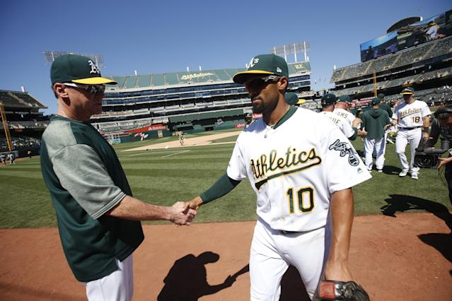 OAKLAND, CA - JUNE 19: Manager Bob Melvin #6 of the Oakland Athletics celebrates with Marcus Semien #10 on the field following the game against the Baltimore Orioles at the Oakland-Alameda County Coliseum on June 19, 2019 in Oakland, California. The Athletics defeated the Orioles 8-3. (Photo by Michael Zagaris/Oakland Athletics/Getty Images)