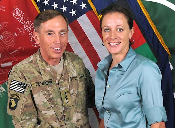 This image from the International Security Assistance Force NATO, shows then ISAF Commander General David Petraeus posing with his biographer Paula Broadwell in Afghanistan, July 13, 2011 (AFP Photo/)