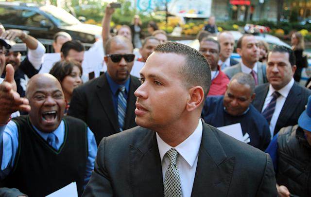 FILE - In this Oct. 1, 2013, file photo, New York Yankees' Alex Rodriguez arrives at the offices of Major League Baseball in New York. The owner of a now-defunct Florida clinic was charged Tuesday, Aug. 5, 2014, with conspiracy to distribute steroids, more than a year after he was accused of providing performance-enhancing drugs to New York Yankees star Alex Rodriguez and other players. Federal court records show Anthony Bosch is charged with one count of conspiracy to distribute testosterone. (AP Photo/David Karp, File)