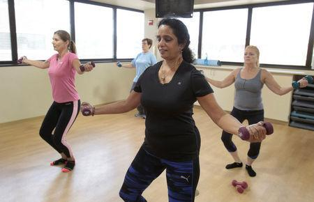 Dr. Anu Puttagunta (C), endocrinologist, participates with hospital staff in a MOVE exercise class at Saint Joseph Mercy hospital in Ypsilanti, Michigan, U.S., August 23, 2017. Picture taken August 23, 2017. REUTERS/Rebecca Cook