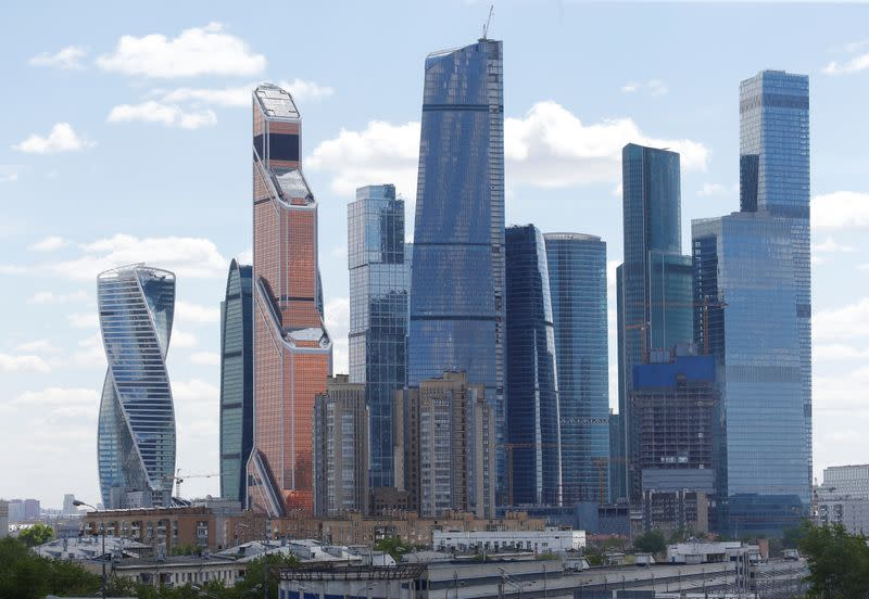 """A general view shows residential buildings in front of the Moscow International Business Center, also known as """"Moskva-City"""", in Moscow"""