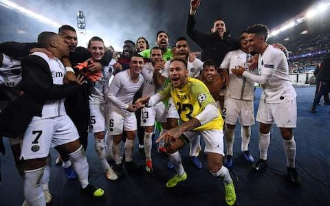 PSG celebrate after narrowly beating Liverpool in the group stages - Credit: afp