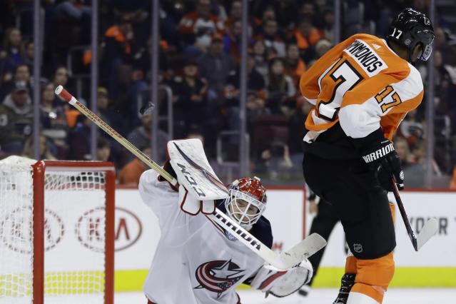 Columbus Blue Jackets' Sergei Bobrovsky, left, blocks a shot as Philadelphia Flyers' Wayne Simmonds tries to screen during the second period of an NHL hockey game Thursday, Dec. 6, 2018, in Philadelphia. (AP Photo/Matt Slocum)