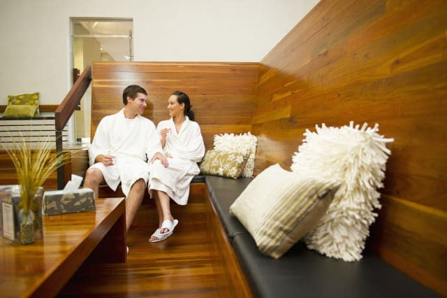 Couple in bathrobes relaxing in spa