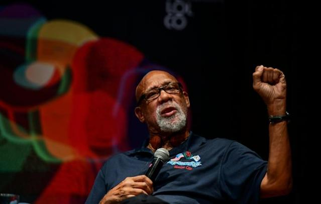 John Carlos has joined calls from US Olympians to end rules banning athletes from protesting at the Olympics (AFP Photo/RONALDO SCHEMIDT)