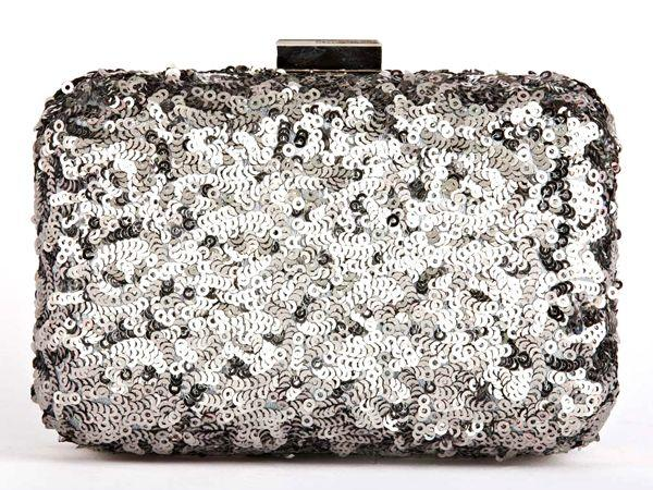 "<p><strong>What</strong>: Sequined box clutch<br /><strong>Why we like</strong>: Add a little razzle and a little dazzle to your look with this silver festive clutch.<br /><strong>Price</strong>: Rs.3,995<br /><strong>Where to buy</strong>: <a href=""https://ec.yimg.com/ec?url=http%3a%2f%2fwww.satyapaul.com%2fsatyapaul%2fshop%2faccessories%2fclutches%2fsi022-0317%26quot%3b&t=1503284682&sig=KvKESIkfri2Av.VvFH3HMw--~D target=""_blank"">Satyapaul.com</a></p>"