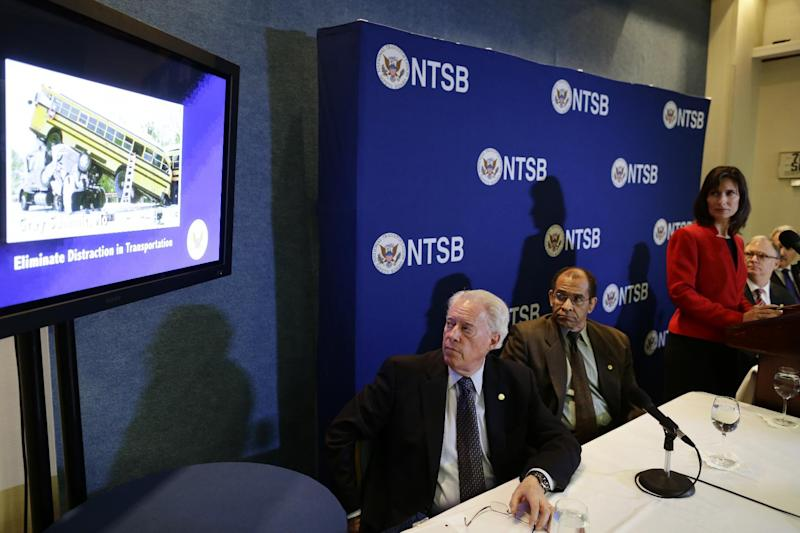 "National Transportation Safety Board (NTSB) Chair Deborah Hersman, third from right, along with board members, from left: Earl F. Weener; Christopher A. Hart; Robert L. Sumwalt; and Mark R. Rosekind watch a video a news conference regarding its 2013 ""Most Wanted List"" of transportation challenges, Wednesday, Nov. 14, 2012, during a news conference at the National Press Club in Washington. (AP Photo/Charles Dharapak)"
