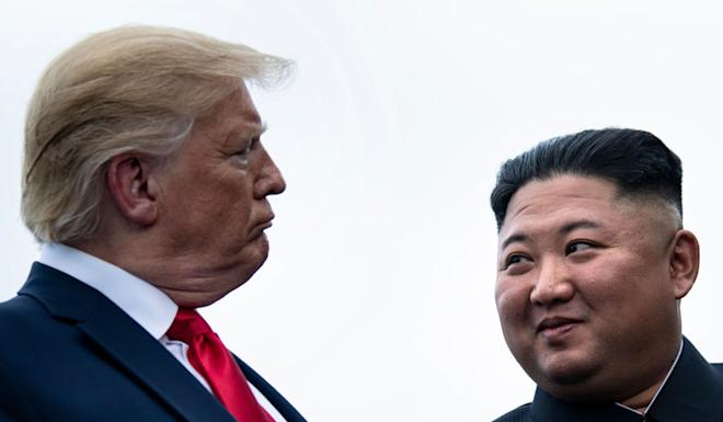 Trump and Kim talk before a 2019 meeting in the demilitarised zone. Photo: AFP