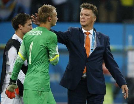 Netherlands coach Van Gaal consoles goalkeeper Cillessen after their 2014 World Cup semi-finals against Argentina in Sao Paulo
