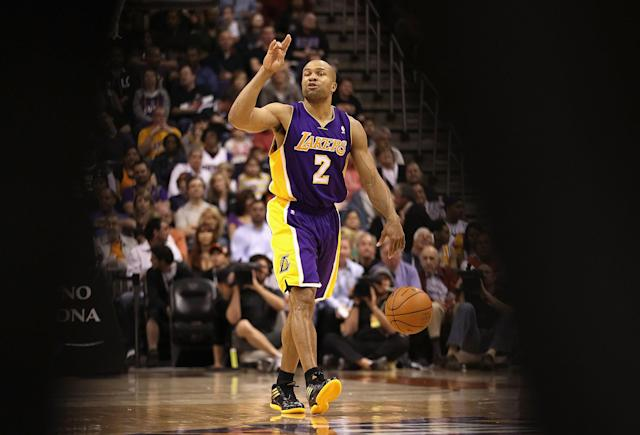 PHOENIX, AZ - FEBRUARY 19: Derek Fisher #2 of the Los Angeles Lakers moves the ball upcourt during the NBA game against the Phoenix Suns at US Airways Center on February 19, 2012 in Phoenix, Arizona. NOTE TO USER: User expressly acknowledges and agrees that, by downloading and or using this photograph, User is consenting to the terms and conditions of the Getty Images License Agreement. (Photo by Christian Petersen/Getty Images)