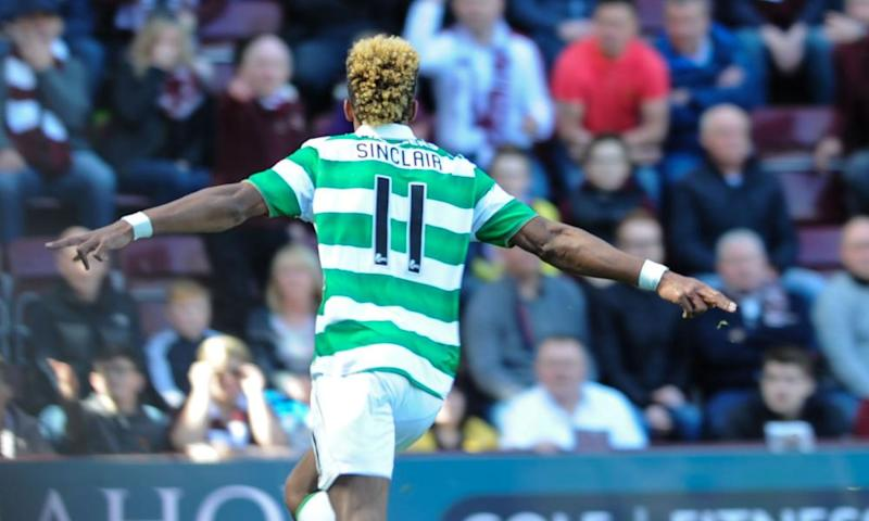 Scott Sinclair celebrates scoring his second goal in Celtic's 5-0 win over Hearts, which sealed the title for Brendan Rodgers' side.