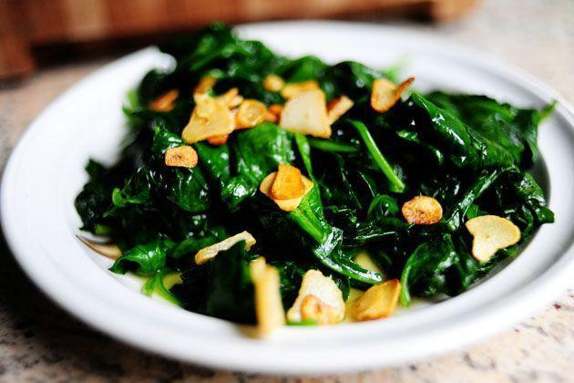 "<p>This spinach dish isn't just for Popeye! It's sprinkled with crisp, golden garlic chips for a pop of flavor and texture the whole family will love. It's so simple and delicious, you'll forget it's also good for you.</p><p><strong><a href=""https://www.thepioneerwoman.com/food-cooking/recipes/a11301/spinach-with-garlic-chips/"" rel=""nofollow noopener"" target=""_blank"" data-ylk=""slk:Get the recipe."" class=""link rapid-noclick-resp"">Get the recipe. </a></strong></p><p><strong><a class=""link rapid-noclick-resp"" href=""https://go.redirectingat.com?id=74968X1596630&url=https%3A%2F%2Fwww.walmart.com%2Fsearch%2F%3Fquery%3Dpioneer%2Bwoman%2Bdishes&sref=https%3A%2F%2Fwww.thepioneerwoman.com%2Ffood-cooking%2Fmeals-menus%2Fg35256361%2Feaster-side-dishes%2F"" rel=""nofollow noopener"" target=""_blank"" data-ylk=""slk:SHOP DISHES"">SHOP DISHES</a><br></strong></p>"