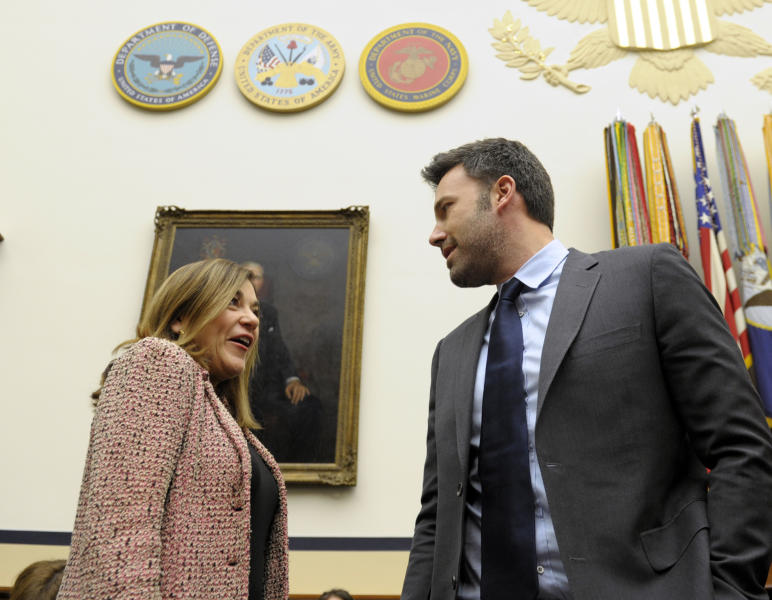 Ben Affleck, actor and founder of the Eastern Congo Initiative, talks with Rep. Loretta Sanchez, D-Calif., as he arrives to testify before the House Armed Services Committee on the evolving security situation in the Democratic Republic of the Congo during a hearing on Capitol Hill in Washington, Wednesday, Dec. 19, 2012. (AP Photo/Susan Walsh)