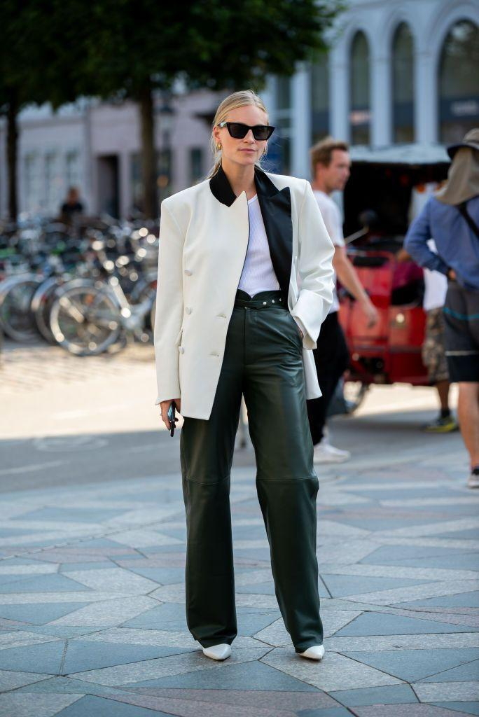 <p>Leather or faux-leather trousers amp up any streamlined look, even when paired with a simple white tee and blazer.</p>