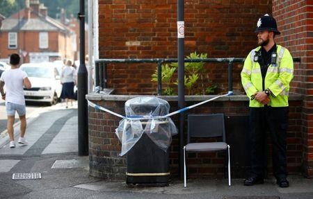 A police officer guards a cordoned off rubbish bin on Rolleston Street, after it was confirmed that two people had been poisoned with the nerve-agent Novichok, in Salisbury