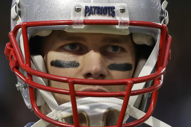 """FILE - In this Feb. 4, 2018, file photo, New England Patriots quarterback Tom Brady warms up before the NFL Super Bowl 52 football game against the Philadelphia Eagles in Minneapolis. Brady, the centerpiece of the New England Patriots' championship dynasty over the past two decades, appears poised to leave the only football home he has ever had. The 42-year-old six-time Super Bowl winner posted Tuesday, March 17, 2020, on social media """"my football journey will take place elsewhere."""" The comments were the first to indicate the most-decorated player in NFL history would leave New England. (AP Photo/Matt Slocum, File)"""