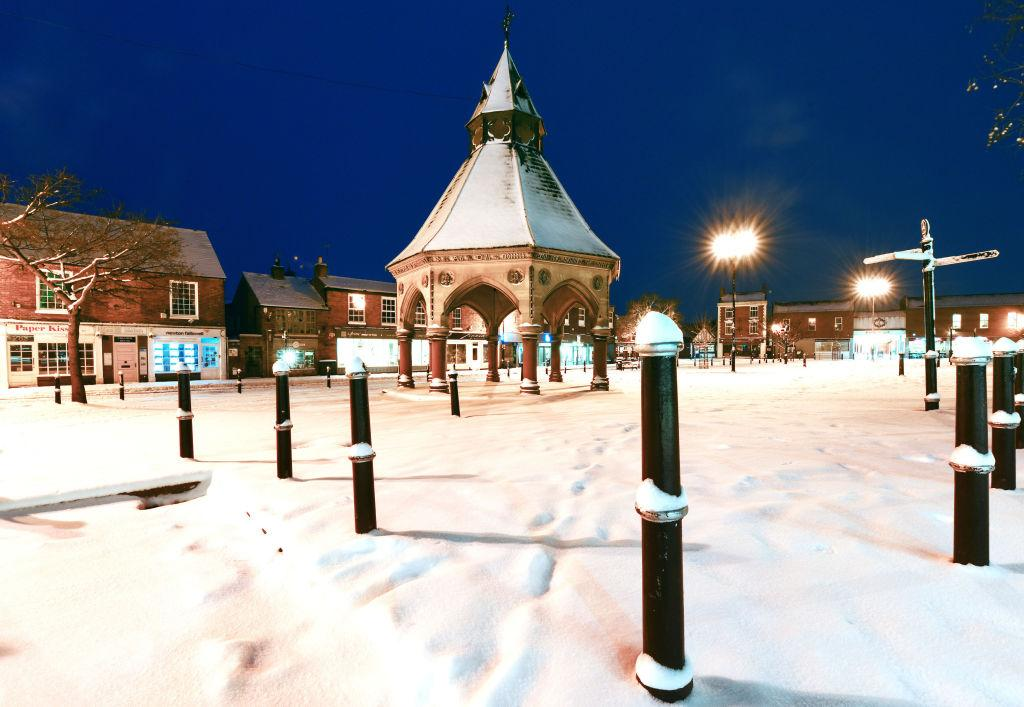 <p>Snow blankets the Market Square in Bingham, Nottinghamshire, as another day of sub-zero temperatures, gale-force icy winds and blizzard-like conditions is expected. (Getty) </p>