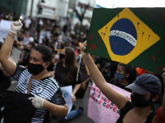 Protesters take to the streets in Brazil to denounce far-right President Jair Bolsonaro and show solidarity with George Floyd (REUTERS)