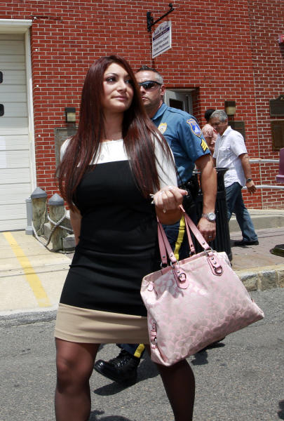 """""""Jersey Shore"""" cast member Deena Cortese walks from court after a hearing Tuesday, July, 3, 2012, in Seaside Heights, N.J. The Cortese was in Seaside Heights municipal court on a change of interfering with traffic for an incident in which police say she was dancing in a street and blocking the flow of traffic. She pleaded guilty to failing to use the sidewalk and paid a $106 fine. (AP Photo/Mel Evans)"""