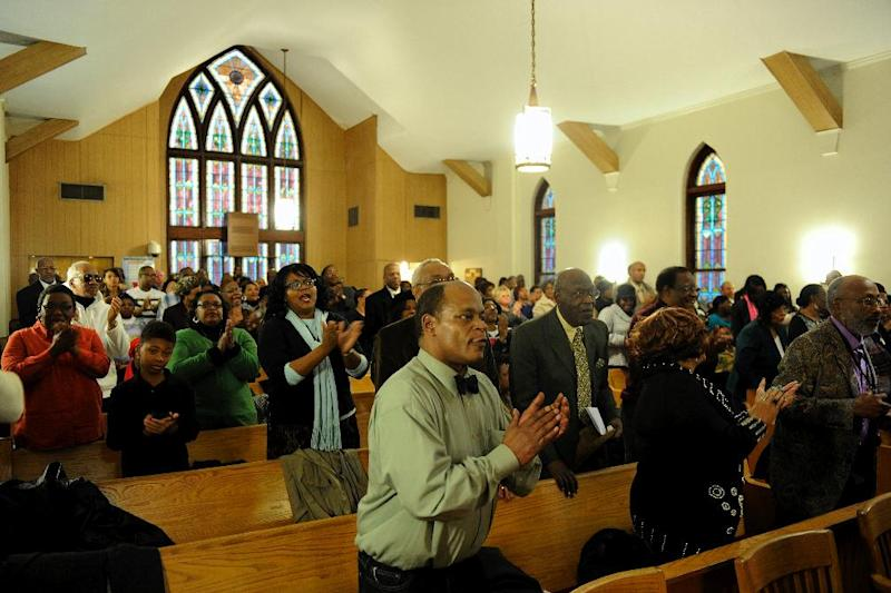 People stand and clap during the music portion of the Black History Committee's celebration of Dr. Martin Luther King, Jr's birthday at Greater Norris Chapel Baptist Church in Henderson, Ky Sunday Jan. 19, 2014. (AP Photo/The Gleaner, Darrin Phegley)