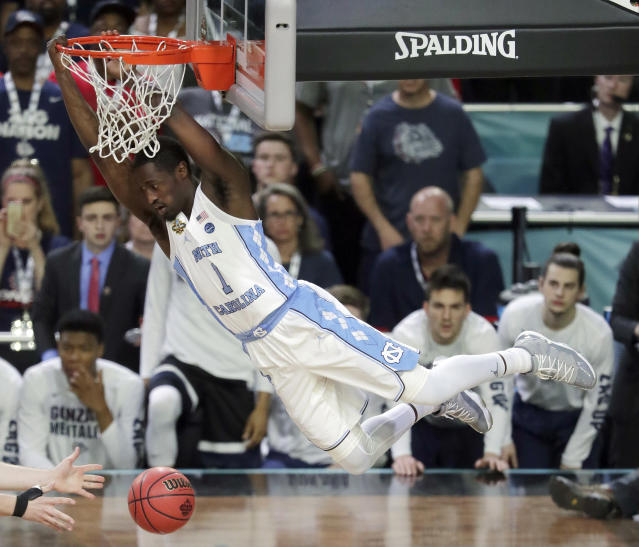 "North Carolina's <a class=""link rapid-noclick-resp"" href=""/ncaab/players/126177/"" data-ylk=""slk:Theo Pinson"">Theo Pinson</a> (1) dunks during the first half of the national title game against Gonzaga on April 3, 2017, in Glendale, Ariz. (AP Photo/Matt York)"