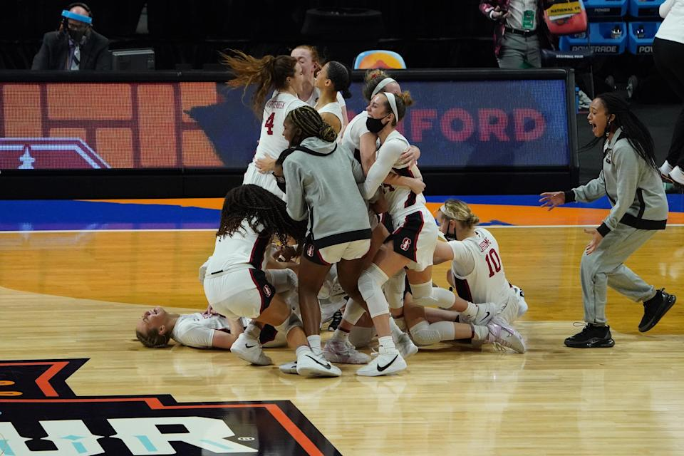 Stanford players celebrate after defeating Arizona to win the 2021 NCAA women's basketball tournament.