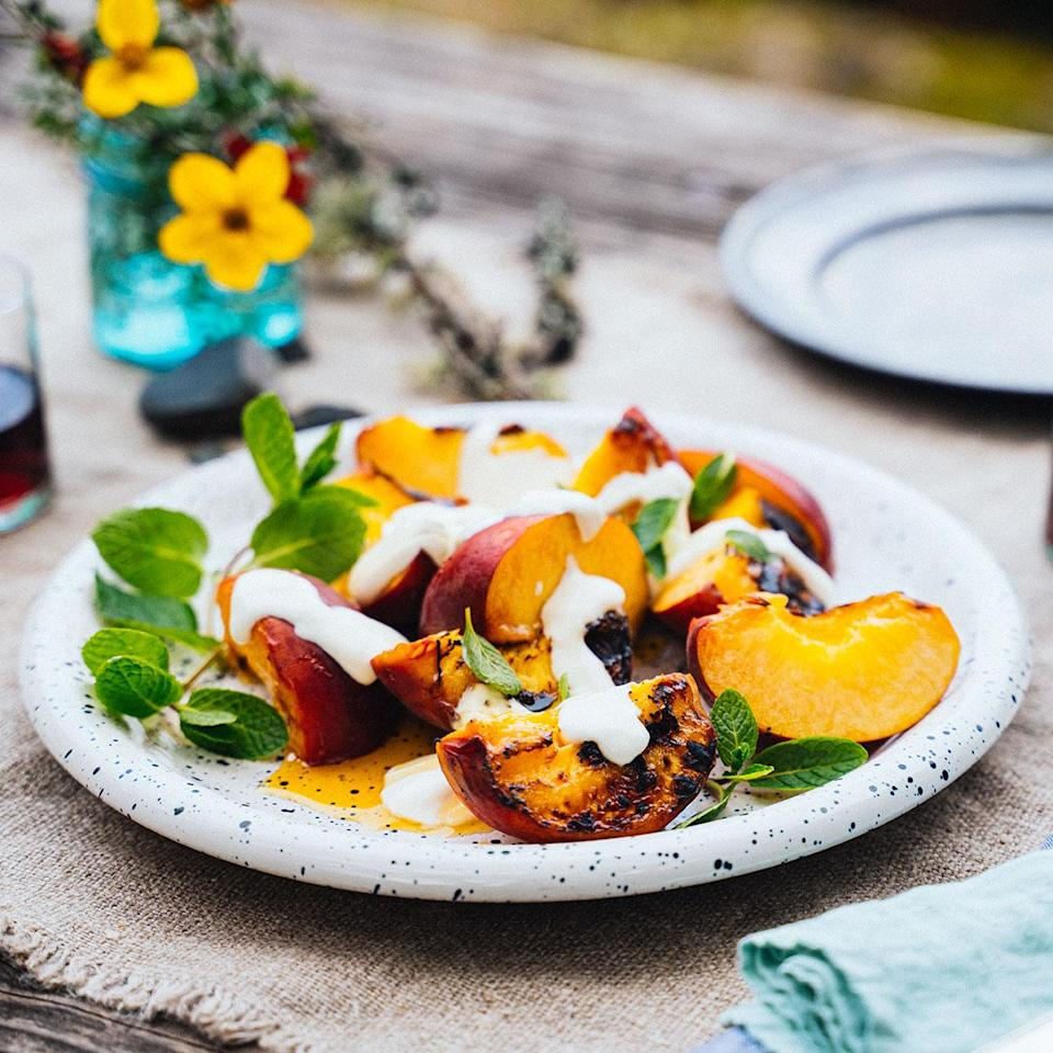 <p>Here's a new idea for dessert on a camping trip or in the backyard. Because you don't need the recipe for s'mores. But you could totally crumble some graham crackers on top to add some crunch to these grilled peaches.</p>