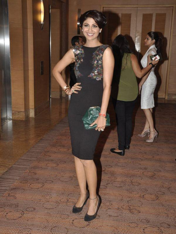 <p><strong>Shilpa Shetty: </strong>The beautiful mommy wore a black cocktail dress by Rajat Tangri. We love that hairdo too!</p>