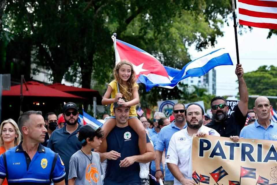 Mia Chacon with his father Omar Chacon, joined a group of Cuban exiles on a march by the Kiwanis Club of Little Havana along Calle 8 to the Bay of Pigs Heroes Monument, to show solidarity and support for the Cuban people asking for freedom and the end of 62 years of an oppressive authoritarian regime on the island. on July Friday 23, 2021.